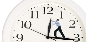 clock-hands-being-pushed-back-by-a-business-man